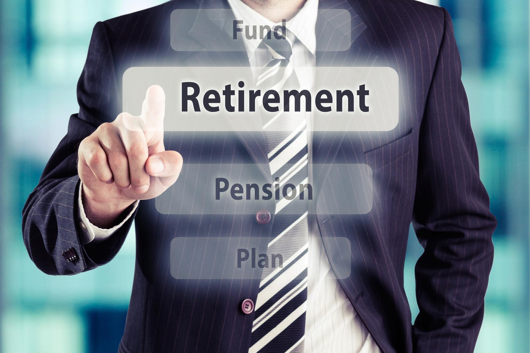 Man pressing retirement button. Retirement concept, toned photo.
